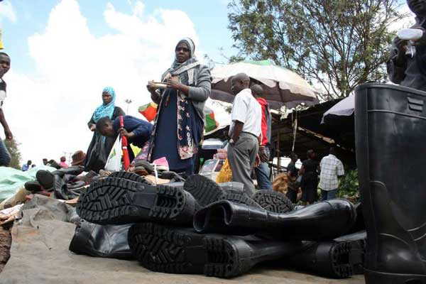 Traders sell gumboots at Nairobi's Kangemi market ahead of the anticipated heavy rains. Experts have said the rains that have started falling could be an indication of the onset of El Niño rains. PHOTO | ROBERT NGUGI | NATION MEDIA GROUP